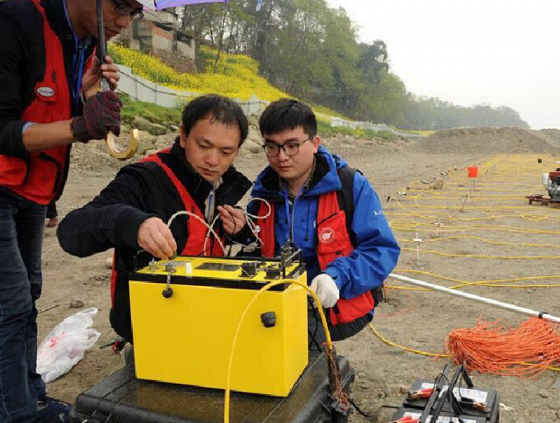 Joint research team setting up survey equipment