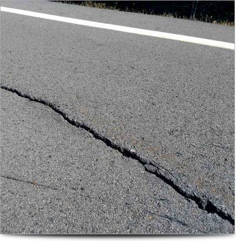 AGI Case History - Ozark Landslide - Cracked Pavement